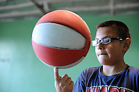 Keeping his eyes on the ball, future Globetrotter Jose Garcia, 11, practices his basketball skills at the Breadbox Recreation Center in east Salinas. Garcia is a 6th-grader at nearby Martin Luther King Jr. Academy.