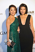 HONG KONG - MARCH 14:  Michelle Yeoh (left) and a friend arrive on the red carpet during the 2015 amfAR Hong Kong gala at Shaw Studios on March 14, 2015 in Hong Kong. Photo : Lucas Schifres/Abaca  (Photo by Lucas Schifres/Lucas Schifres)