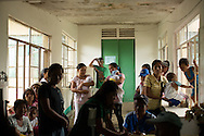 Patients line up in the outpatient ward at the Tapaz District Hospital in the province of Capiz on Panay Island, Philippines.  Almost a month after Typhoon Yolanda (aka Typhoon Haiyan), the hospital roof still leaks in many places.