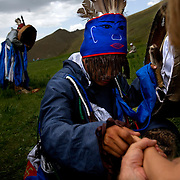 Autistic child Rowan, 5, attend a shaman ritual in Mongolia, accompanied by his parents Rupert and Kristin, their Mongolian guide Tulga, his six-year-old son Bodibilguunson and an American documentary TV crew. .Rowan's parents believe horses and shamans can unlock their sonís autistic mind. This is their journey of discovery across Mongolia on horseback. .The story is published by the Sunday Times and accompany text by Tim Rayment.