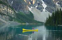 Canoeist paddling on Moraine Lake, Banff National Park Alberta Canada