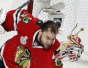 Antti Niemi loses his helmet as he makes a save off his facemask in the third period of Game 1 of the Chicago Blackhawks 6-5 win against the Philadelphia Flyers in the Stanley Cup Finals at the United Center on Saturday, May 29, 2010.<br /> <br /> (Brian Cassella/ Chicago Tribune) B58470436Z.1<br /> ....OUTSIDE TRIBUNE CO.- NO MAGS,  NO SALES, NO INTERNET, NO TV, NEW YORK TIMES OUT, CHICAGO OUT, NO DIGITAL MANIPULATION...