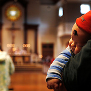 Three month old Arro Mills rests against his grandfathers shoulder Chuck Mills, of Beaufort, during an Ash Wednesday service at St. Peter's Catholic Church at 70 Lady's Island Drive on March 5, 2014.