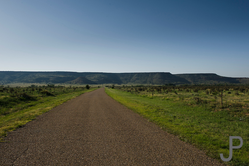 An empty paved road leads to Black Mesa, highest point in Oklahoma right in the far northwestern panhandle touching New Mexico.