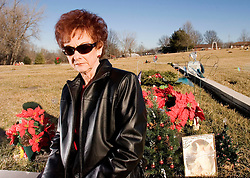 19 Jan, 2006. Eminem's maternal grandmother Betty Kresin sits beside the graves of her sons Todd and Ronnie at the small St Joseph cemetery, Kansas. A small rural town where rap star Marshall Bruce Masthers III, aka Eminem's uncles lie buried. Eminem has never been to visit his uncle's graves.<br /> Photo; Charlie Varley/varleypix.com