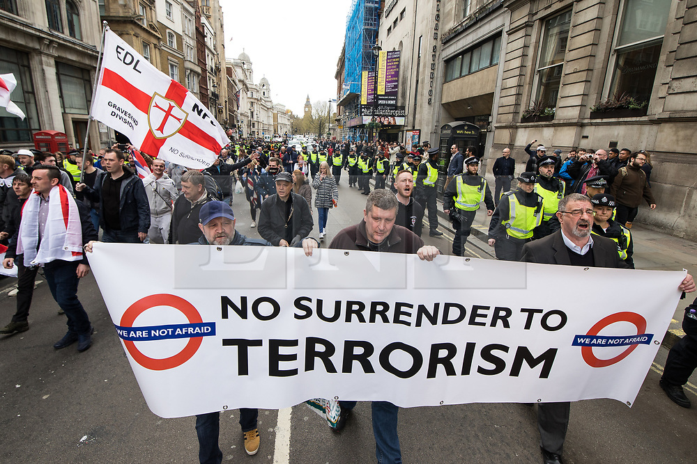 © Licensed to London News Pictures . 01/04/2017 . London , UK . The EDL demonstration marches along Whitehall . The EDL and Britain First both hold demonstrations in London , opposed by anti-fascist groups , including Unite Against Fascism . Photo credit : Joel Goodman/LNP