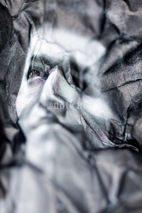 crumbled newspaper with portrait