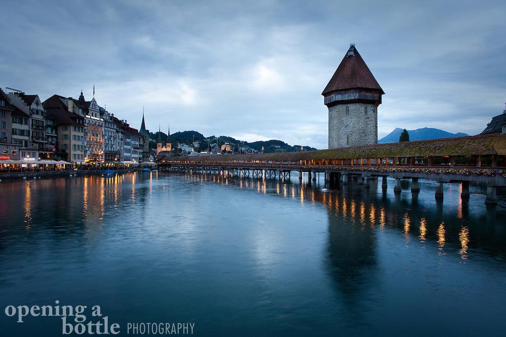 The Kapellbrücke crosses the Reuss River, as taken during dusk, Lucerne, Switzerland.