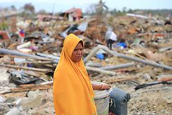 November 1, 2018 - Palu, Central Sulawesi, Indonesia - People collect used goods and iron from homes affected by liquefaction in Petobo, Palu, central Sulawesi, 32 days after quake-tsunami-liquefaction hit Central Sulawesi. A deadly earthquake measuring 7.5 magnitude and the tsunami wave caused by it has destroyed the city of Palu and much of the area in Central Sulawesi. According to officials, the death toll from the devastating quake and tsunami has risen to 2088, around 5000 people in hospitals are seriously injured and some 62,000 people have been displaced (Credit Image: © Risa Krisadhi/Pacific Press via ZUMA Wire)