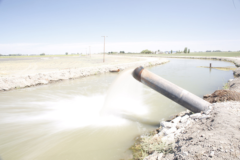 Seepage is pumped back into the primary irrigation canal near Firebaugh CA, on the west side of the San Joaquin valley.  August 18, 2014.