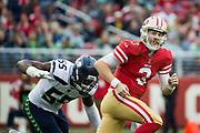 San Francisco 49ers quarterback C.J. Beathard (3) scrambles from the Seattle Seahawks defense at Levi's Stadium in Santa Clara, Calif., on November 26, 2017. (Stan Olszewski/Special to S.F. Examiner)