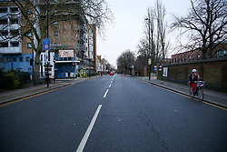 © Licensed to London News Pictures. 05/01/2021. London, UK. A cyclist on an empty St Ann's Road in Haringey, north London as England begins its third national lockdown. St Anns Road is normally busy in the morning with school traffic. Prime Minister Boris Johnson announced on Monday 4 January 2021 that England goes into third national lockdown until at least 22 February 2021, with households ordered to stay home and only go outside for the specific reasons. Photo credit: Dinendra Haria/LNP