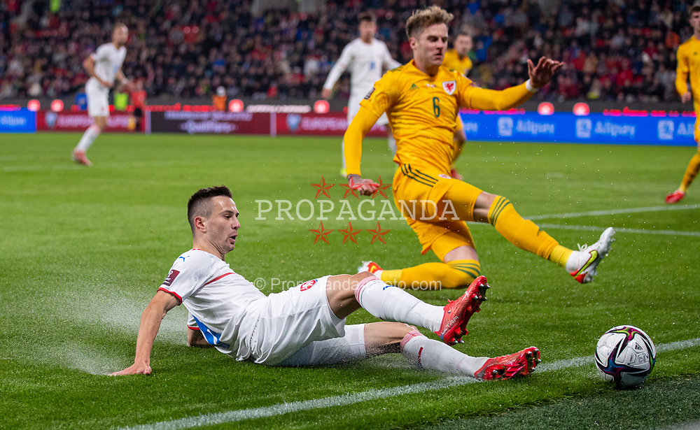 PRAGUE, CZECH REPUBLIC - Friday, October 8, 2021: Czech Republic's Jakub Pešek (L) and Wales' Joe Rodon during the FIFA World Cup Qatar 2022 Qualifying Group E match between Czech Republic and Wales at the Sinobo Stadium. The game ended in a 2-2 draw. (Pic by David Rawcliffe/Propaganda)