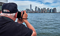 Tourist view of Manhattan from the Ellis Island ferry. Image taken with a Fuji X-T2 camera and 18-55 mm zoom lens (ISO 200, 18 mm, f/22, 1/80 sec).