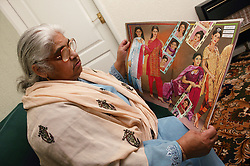South Asian lady reading a magazine,