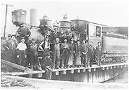 """RGS 2-8-0 #18 on turntable with Ridgway roundhouse crew.<br /> RGS  Ridgway, CO  ca 1909-1910<br /> In book """"Rio Grande Southern II, The: An Ultimate Pictorial Study"""" page 13<br /> Same as RD124-062.<br /> Also in """"RGS Story Vol. I"""", p. 114 and """"The Rio Grande Southern Railroad"""", p. 321."""