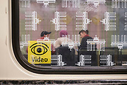 A sign notifying of security closed circuit video cameras is seen on a window in Berlins U-Bahn metro train.