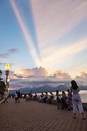 Puerto Princesa, Palawan, Philippines - July 5, 2019: People enjoy sunset at the Puerto Princesa City Baywalk Park.