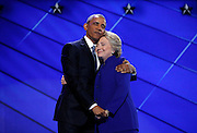 Democratic presidential nominee Hillary Clinton hugs U.S. President Barack Obama as she arrives onstage at the end of his speech on the third night of the 2016 Democratic National Convention in Philadelphia, Pennsylvania, U.S., July 27, 2016. REUTERS/Jim Young