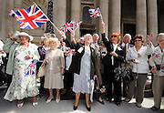 14/07/2009 WWII Evacuees leave a service at St Paul's Cathedral in central London. Many of the guests had not met since the end of the war when they returned to their families in cities all over Britain. Their were many surprises in store as they bumped into old friends. Many of the evacuees stood on the steps and sang wartime favourites, 'we'll meet again' and 'Land of Hope and Glory' whilst waving flags..