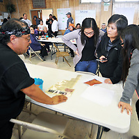 """Frank Smith, left, listens to a participant tell her """"bigfoot"""" sighting story. 1 of many participants who shared their stories . Smith is the organizer of ithe 3rd Annual Bigfoot Seminar Saturday in Sanostee."""