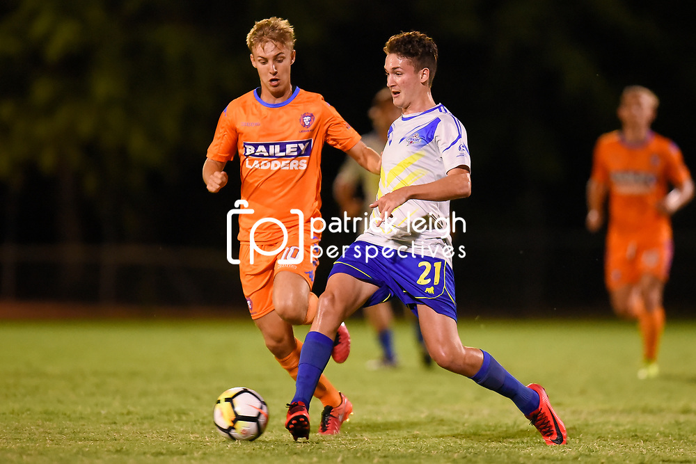 BRISBANE, AUSTRALIA - JANUARY 27: Sebastian Scaroni of the Strikers passes the ball under pressure from Jesse Daley of Lions during the Kappa Silver Boot Grand Final match between Lions FC and Brisbane Strikers on January 27, 2018 in Brisbane, Australia. (Photo by Patrick Kearney)