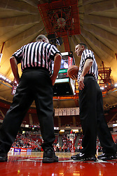 21 November 2009: A pair of basketball officials talk in the baseline area under the pleated roof of the arena waiting for play to resume. The Ospreys of North Florida fall to the Redbirds of Illinois State 71-55 on Doug Collins Court inside Redbird Arena in Normal Illinois.