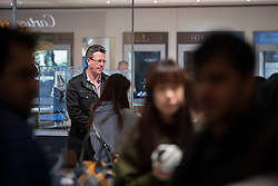 © Licensed to London News Pictures . 26/12/2015 . Manchester , UK . A man stands alone as shoppers scoop up handbags at the Selfridges winter sale . Photo credit: Joel Goodman/LNP