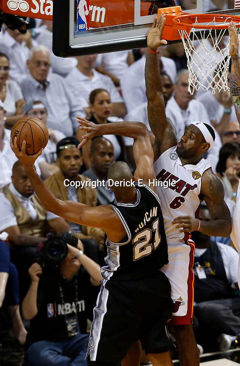 Jun 6, 2013; Miami, FL, USA; Miami Heat small forward LeBron James (6) defends the shot by San Antonio Spurs power forward Tim Duncan (21) in the fourth quarter during game one of the 2013 NBA Finals at the American Airlines Arena. Mandatory Credit: Derick E. Hingle-USA TODAY Sports