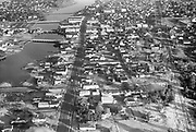 Ackroyd_05791-3. Seaside business district aerial. January 19, 1955.