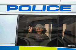 © Licensed to London News Pictures. 09/10/2019. London, UK. XR activist in the back of a police van outside the MOD waves to her supporters. Activists continue to occupy roads around Westminster for the 3nd day. Photo credit: Alex Lentati/LNP