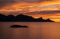 Colorful sunset at Haukland Beach, Vestvågøya, Lofoten Islands, Norway