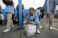 Pop joins former prison inmates in waiting for their bus at the Grey Hound bus station.