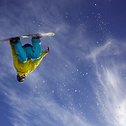 Ryan Pappas, 22, from Sydney, Australia, performs a backside rodeo 540 as he takes to the air at The Remarkables Ski Fields, Queenstown, New Zealand during a session with 'The Air Bag'  a large inflatable airbag which breaks the fall of the participant on landing and allows valuable experience and a training aid for Aerial skiers and snowboarders. Queenstown, South Island, New Zealand, 23rd July 2011
