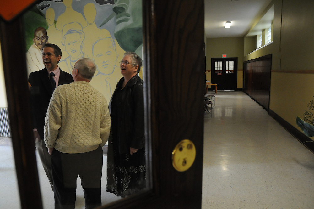 St. Eulalia Director of Liturgy and Music Steve Janco chats with parishioners in the mural-graced entryway of the church's newly-inaugurated Quinn Community Center in Maywood. The project to revitalize the building was undertaken by Pastor Carmelo Mendez, naming the center for former St. Eulalia Pastor William Quinn. Quinn made a lasting history for himself as a pioneer for social justice, both in the fields of civil rights, along with those of immigrants in the U.S. He died in 2004.