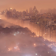 New York's Central Park shrouded in fog shows the extent of urban lighting in one of the world's major metropolitan areas.