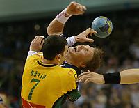 Håndball,<br /> Handball Champions League Finale <br /> Flensburg Handewitt - Pivovarna Celje<br /> v.l. Marco Ostir, Johnny Jensen<br /> Foto: Digitalsport