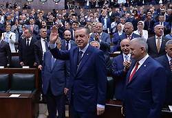 June 13, 2017 - Ankara, Turkey - Turkish President and Chairman of the Justice and Development Party (AK Party) Recep Tayyip Erdogan (C) and Turkish Prime Minister Binali Yildirim (R) attend an AK Party's group meeting at the Grand National Assembly of Turkey (TBMM) in Ankara. (Credit Image: © Depo Photos via ZUMA Wire)