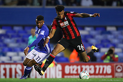 Birmingham City's Isaac Vassell (left) and AFC Bournemouth's Tyrone Mings during the Carabao Cup, Second Round match at St Andrew's, Birmingham.