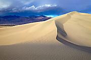 Breaking thunderstorm over Mesquite Dunes, Death Valley National Park, California