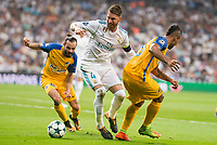 Real Madrid's Sergio Ramos and Apoel's Stathis Aloneftis and Lorenzo Ebecillo during UEFA Champions League match between Real Madrid and Apoel at Santiago Bernabeu Stadium in Madrid, Spain September 13, 2017. (ALTERPHOTOS/Borja B.Hojas)