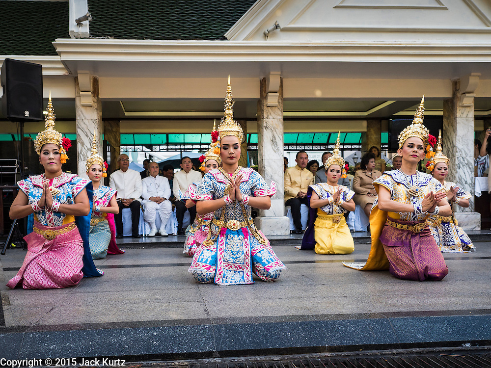 "04 SEPTEMBER 2015 - BANGKOK, THAILAND:  Classical Thai dancers perform in front of the Erawan Shrine Friday. A ""Holy Religious Ceremony for Wellness and Prosperity of our Nation and Thai People"" was held Friday morning at Erawan Shrine. The ceremony was to regain confidence of the Thai people and foreign visitors, to preserve Thai religious customs and traditions and to promote peace and happiness inThailand. Repairs to Erawan Shrine were completed Thursday, Sept 3 after the shrine was bombed on August 17. Twenty people were killed in the bombing and more than 100 injured. The statue of the Four Faced Brahma in the shrine was damaged by shrapnel and a building at the shrine was damaged by debris.    PHOTO BY JACK KURTZ"