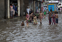 August 3, 2017 - Dhaka, Bangladesh - Children playing in water logged by heavy rainfall in Dhaka, Bangladesh on August 03, 2017...Venturing outdoors may become deadly across wide swaths of Bangladesh, India and Pakistan by the end of the century as climate change drives heat and humidity to new extremes, according to a new study...Climate change could soon make it fatal to even go outside in some parts of the world, according to a new study...Temperatures could soar so much in southern Asia by the end of the century that the amount of heat and humidity will be impossible to cope with and anyone going outside would die...The study used new research that looked at the way humidity changes how people's bodies can deal with heat. Temperatures and the amount of moisture will mean that the body will simply be unable to cool itself and so people will die, the researchers found...The regions likely to be hardest hit include northern India, Bangladesh and southern Pakistan, home to 1.5 billion people. (Credit Image: © Zakir Hossain Chowdhury/NurPhoto via ZUMA Press)