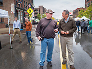 19 OCTOBER 2019 - DES MOINES, IOWA: MARK SANFORD (R-SC), right, talks to a visitor at the Des Moines Farmers' Market during a campaign visit to the market Saturday. Sanford, a former Republican governor and Congressman from South Carolina, is challenging incumbent President Donald Trump for the Republican nomination for the US presidency. Iowa hosts the first event of the presidential selection cycle. The Iowa Caucuses are scheduled for February 3, 2020.              PHOTO BY JACK KURTZ