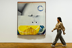 "© Licensed to London News Pictures. 10/09/2019. LONDON, UK. A staff member walks by ""Morning Sung"", 1963, at a preview of ""Visualising the Sixties"", the first in depth exhibition of works by artist James Rosenquist.  From a painter of commercial billboards in New York City, to a fine art career as a Pop artist, Rosenquist's work was described as Andy Warhol's favourite.  The exhibition is on at Galerie Thaddaeus Ropac in Mayfair 10 September to 9 November.  Photo credit: Stephen Chung/LNP"