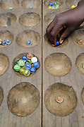 Traditional board game<br /> Mbomo Village<br /> Odzala - Kokoua National Park<br /> Republic of Congo (Congo - Brazzaville)<br /> AFRICA