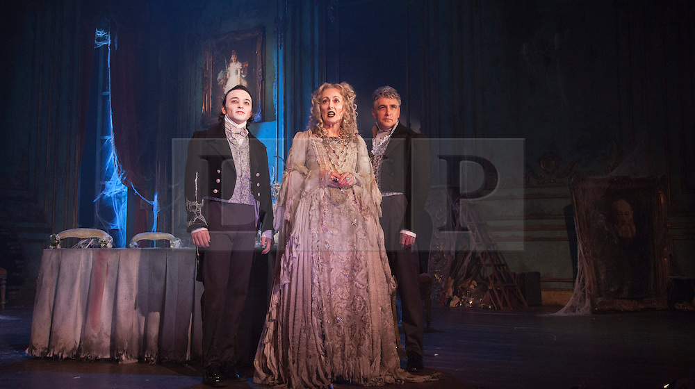 """© Licensed to London News Pictures. 04/02/2013. London, England. Taylor Jay-Davies as Young Pip, Paula Wilcox as Miss Havisham and Paul Nivison as Adult Pip. A new stage adaptation of Charles Dickens's """"Great Expecations"""" will open at the Vaudeville Theatre, London, on Wednesday, 6 February 2013. It is the first ever full-scale stage play of Great Expectations in either the West End or on Broadway. Adaptation by Jo Clifford, directed by Graham McLaren. Photo credit: Bettina Strenske/LNP"""