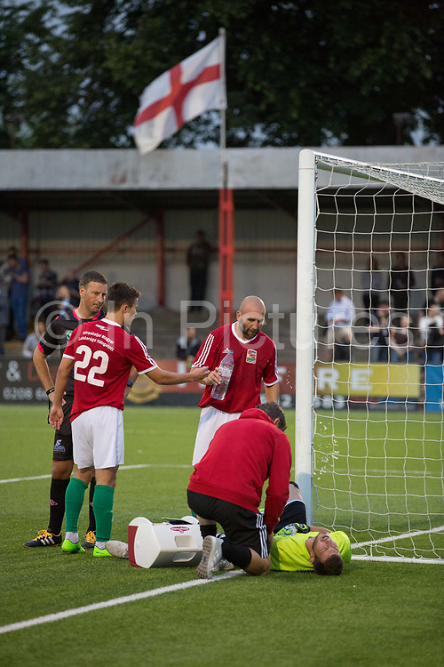 Players and staff see to the Karpatalya goalkeeper during a 4 - 2 victory for Karpatalya red against Szekely Land blue during the Conifa Paddy Power World Football Cup semi finals on the 7th June 2018 at Carshalton Athletic Football Club in the United Kingdom. The CONIFA World Football Cup is an international football tournament organised by CONIFA, an umbrella association for states, minorities, stateless peoples and regions unaffiliated with FIFA.