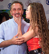 Latin recording artists Emilio Estefan (L) and Thalia joke with each other following a news conference to promote the upcoming Latin Grammy Awards in .Miami, Florida.