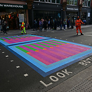 Mayor of London, Sadiq Khan launches Let's Do London Autumn culture season with spectacular public street art installations. Joined by artist Yinka Ilori, and photographer Rankin to unveil Bring London Together – a spectacular new public art commission transforming 18 pedestrian crossings with distinctive playful designs using a bright colour pallet and bold forms. The 'Bring London Together'  at Tottenham Court Road on 2021-09-16 London, UK.